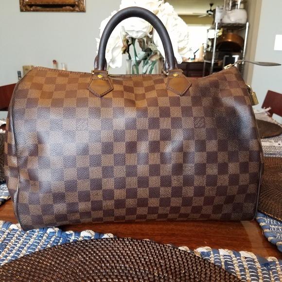 Authentic Louis Vuitton Damier Ebene Speedy 35. Louis Vuitton.  M 5c3c0f6a1b3294d46139370a. M 5c3c0f6efe51512935441861.  M 5c3c0f70aa87709d8858a9f6 4a322743ed857